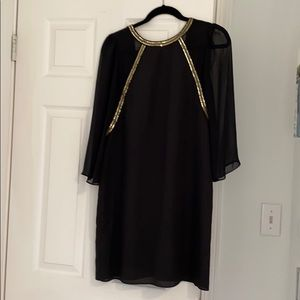 Black dress with gold sequins